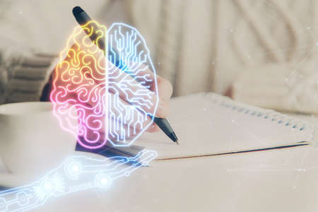 Multi exposure of writing hand on background with brain hologram. Concept of learning.