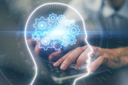 Businessman with computer background with brain theme hologram. Concept of brainstorm. Multi exposure.
