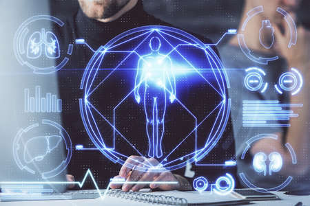 Science hologram with man working on computer on background. Concept of study. Double exposure. Stockfoto