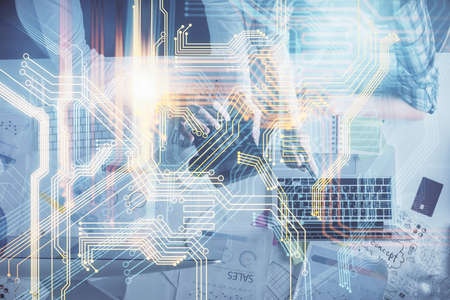 Double exposure of man and woman working together and world map hologram drawing. international network concept. Computer background. Top View. Banque d'images