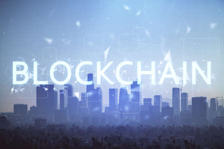 Double exposure of crypto currency theme hologram drawing and city veiw background. Concept of blockchain and bitcoin. Stockfoto
