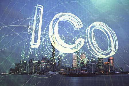 Multi exposure of cryptocurrency theme hologram drawing and city veiw background. Concept of blockchain and bitcoin.