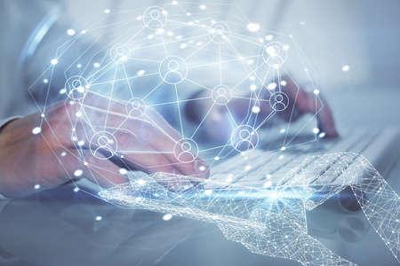 Social network theme hologram with businessman working on computer on background. Multi exposure. Reklamní fotografie