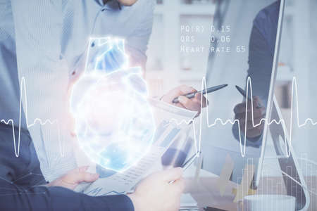 Heart drawing with man working on computer on background. Medical concept. Double exposure. Banque d'images
