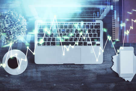 Stock market chart and top view computer on the table background. Double exposure. Concept of financial analysis. 스톡 콘텐츠