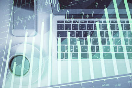 Stock market chart and top view computer on the table background. Multi exposure. Concept of financial analysis. 스톡 콘텐츠