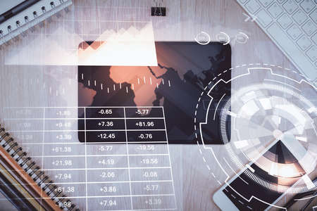 Double exposure of forex graph hologram over desktop with phone. Top view. Mobile trade platform concept.