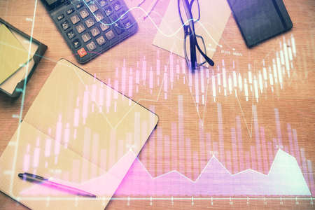 Double exposure of forex graph drawing and work table top veiw. Concept of financial analysis. 스톡 콘텐츠