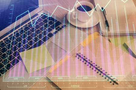 Multi exposure of forex graph drawing and desktop with coffee and items on table background. Concept of financial market trading Imagens