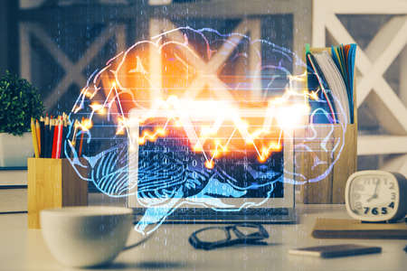 Double exposure of work space with computer and human brain drawing hologram. Brainstorm concept. 免版税图像