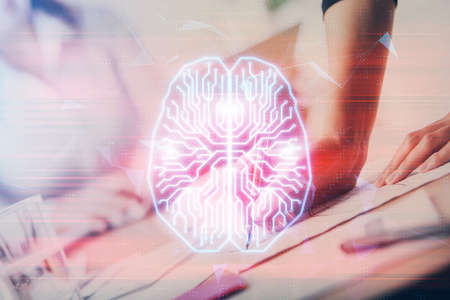 Double exposure of woman's writing hand on background with brain hud. Concept of learning.