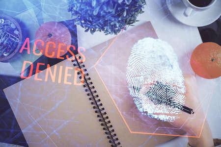 Blue fingerprint hologram over woman's hands taking notes background. Concept of protection. Double exposure Foto de archivo