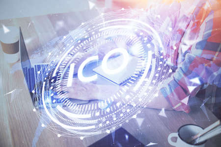 Blockchain theme hologram with man working on computer on background. Concept of crypto chain. Double exposure.