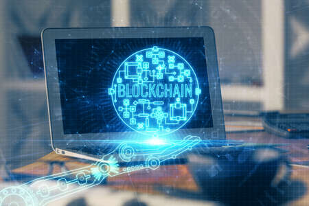 Multi exposure of blockchain theme hologram and table with computer background. Concept of bitcoin crypto currency. Stock fotó