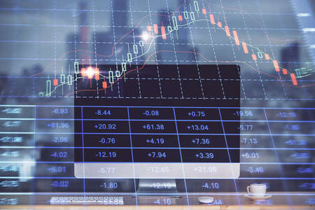 Stock market graph and table with computer background. Multi exposure. Concept of financial analysis.