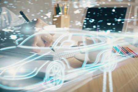 Tech autopilot theme hologram over woman's hands taking notes background. Concept of hightech. Double exposure Foto de archivo