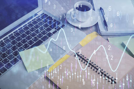 Multi exposure of forex graph drawing and desktop with coffee and items on table background. Concept of financial market trading