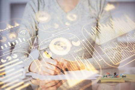 Technology theme hologram over woman's hands taking notes background. Concept of Tech. Double exposure