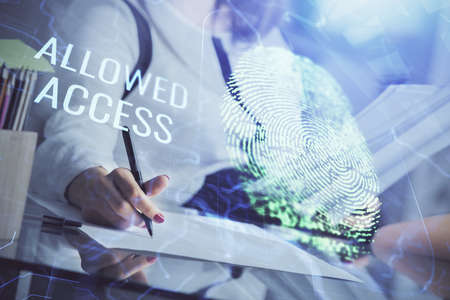 Blue fingerprint hologram over woman's hands taking notes background. Concept of protection. Double exposure