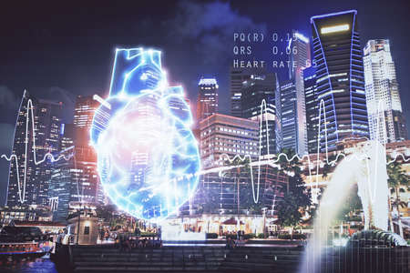 Double exposure of heart icon and cityscape background.