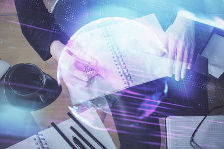Tech theme hologram over woman's hands taking notes background. Concept of hightech. Double exposure