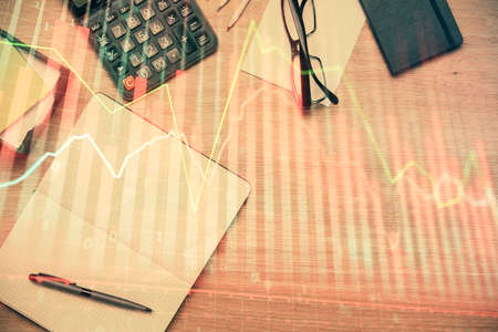 Double exposure of forex graph drawing and work table top veiw. Concept of financial analysis. 版權商用圖片