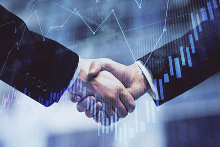 Double exposure of forex graph hologram and handshake of two men. Stock market concept. Banque d'images