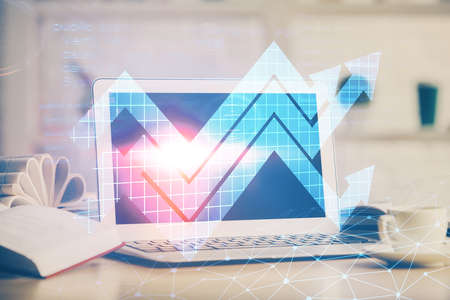 Computer on desktop with point up arrows hologram. Double exposure. Concept of success. Banque d'images