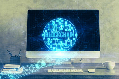 Double exposure of blockchain theme hologram and table with computer background. Concept of bitcoin crypto currency. Banque d'images