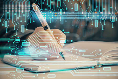 Multi exposure of womans writing hand on background with data technology hologram. Concept of innovation. Banque d'images