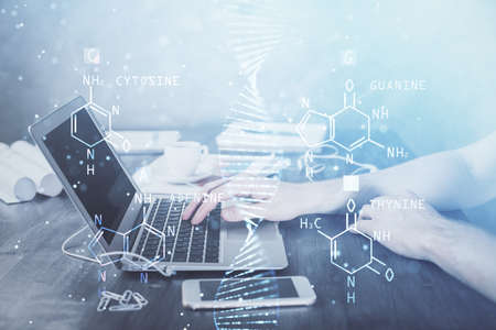 DNA hologram with businessman working on computer on background. Concept of bioengineering. Double exposure. Banque d'images