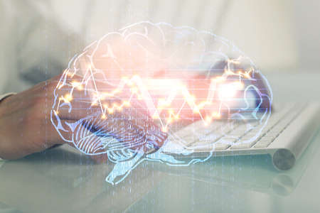 Man with computer background with brain theme hologram. Concept of brainstorm. Double exposure.