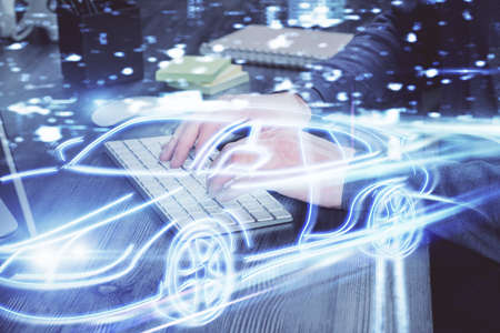 Automobile theme drawing with businessman working on computer on background. Autopilot taxi concept. Double exposure.