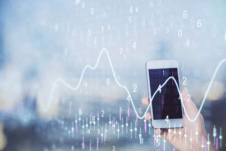 Double exposure of forex chart sketch hologram and woman holding and using a mobile device. Stock market concept.