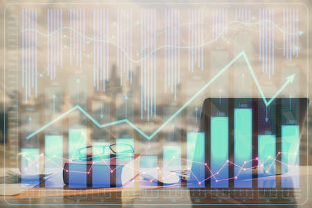Double exposure of financial chart drawings and desk with open notebook background. Concept of forex market