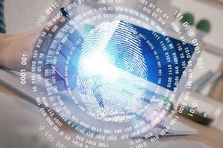 Blue fingerprint hologram over hands taking notes background. Concept of security. Double exposure