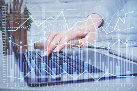 Multi exposure of woman hands typing on computer and forex chart hologram drawing. Stock market analysis concept. Imagens