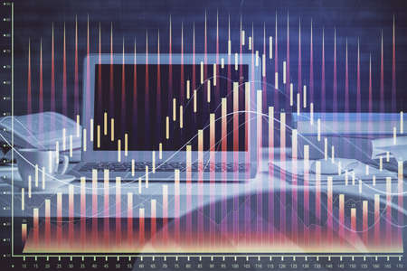 Financial chart drawing and table with computer on background. Multi exposure. Concept of international markets.
