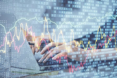 Multi exposure of woman hands typing on computer and financial graph hologram drawing. Stock market analysis concept.