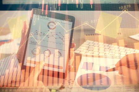 Multi exposure of mans hands holding and using a phone and financial chart drawing. Market analysis concept.