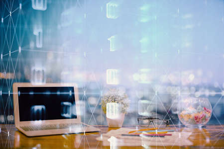Double exposure of table with computer on background and data theme hologram. Data technology concept. 版權商用圖片
