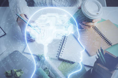 Multi exposure of writing hand on background with brain hologram. Concept of self learning. 스톡 콘텐츠