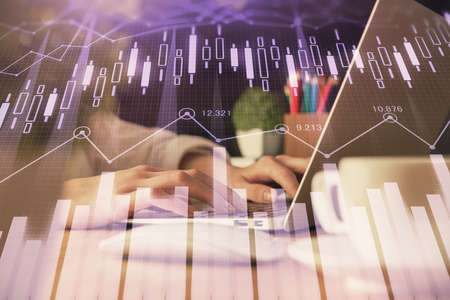 Double exposure of woman hands typing on computer and forex chart hologram drawing. Stock market invest concept. 版權商用圖片