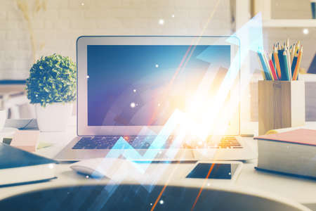 Computer on desktop with point up arrows hologram. Double exposure. Concept of success. Stockfoto