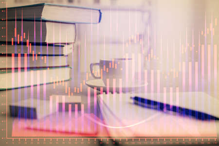 Double exposure of financial chart drawing and desktop with coffee and items on table background. Concept of forex market trading 스톡 콘텐츠