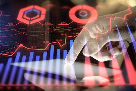 Double exposure of man's hands holding and using a digital device and forex graph drawing. Financial market concept. 免版税图像 - 157226722