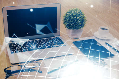 Double exposure of desktop with computer and world map hologram. International data network concept. 写真素材