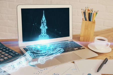 Desktop computer background in office and start up theme hologram drawing. Double exposure. Startup concept. 免版税图像
