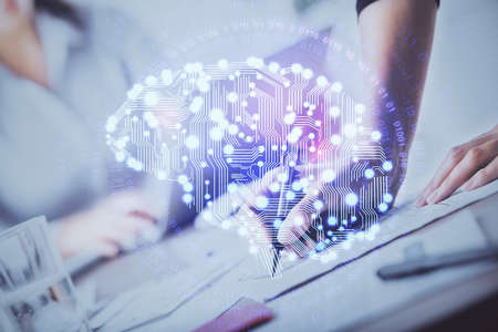Double exposure of womans writing hand on background with brain hud. Concept of learning.