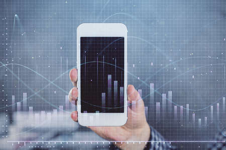 Double exposure of mans hands holding and using a digital device and forex graph drawing. Financial market concept. Stock fotó